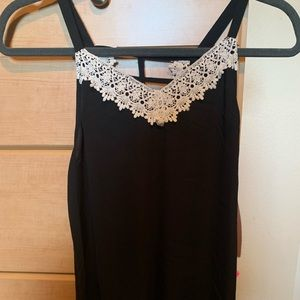 Black tank top with white lace trim